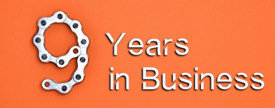 Bicycle chain in shape of 9 for 9 years of business, orange background