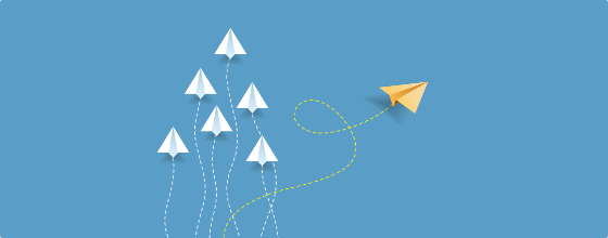 Illustration of six white paper airplanes facing up with one yellow airplane heading to the right on a blue background